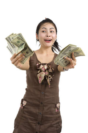 pretty woman holding lots of 100 dollar bills in her hand and almost getting crazy, isolated on white background Stock Photo - 8060030