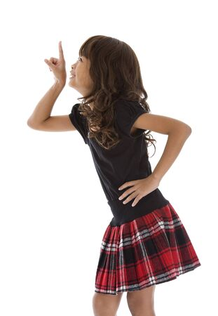 skirt up: cute girl pointing at something, isolated on white background