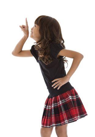 faldas: ni�a bonita apuntando a algo, aislados en fondo blanco  Foto de archivo