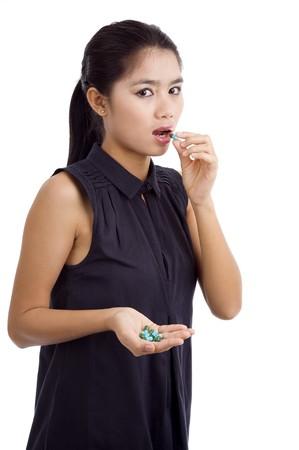 woman taking medicine, isolated on white background photo