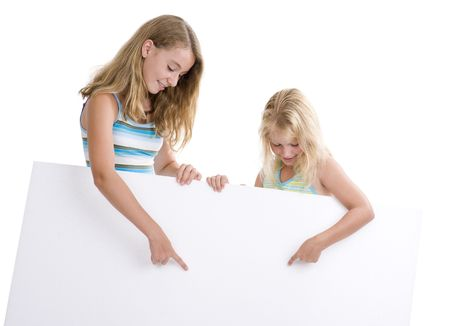 two blond girls holding a blank display board, isolated on white background photo
