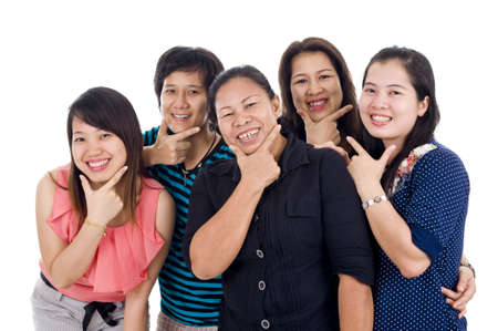 welcome to the land of smile. group of thai women with big smiles on their faces, isolated on white background Stock Photo - 8196138