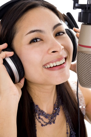 vocals: beautiful woman recording vocals in music studio, isolated on white background