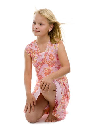 pretty caucasian preteen posing in studio, isolated on white background photo