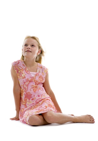 blond caucasian girl sitting isolated on white background photo