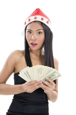 woman with santa claus hat and a lot of money, isolated on white background photo