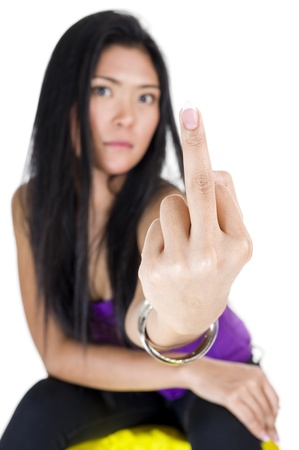 asian beauty showing middle finger, isolated on white background with a shallow depth of field. focused on the finger. photo
