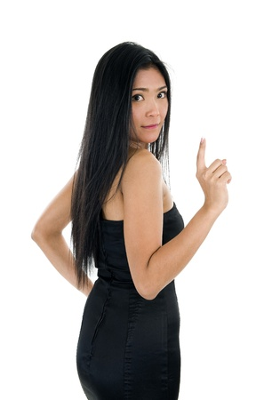 over shoulders: pretty woman looking back over her shoulder with one finger raised, isolated on white background Stock Photo