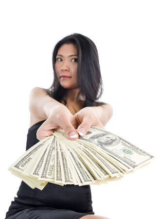a lot of money: woman with a lot of money, isolated on white background. the photograph has a shallow depth of field with focus on the  thumbs. Stock Photo