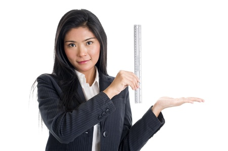 business woman holding a ruler to show the size of something, isolated on white background