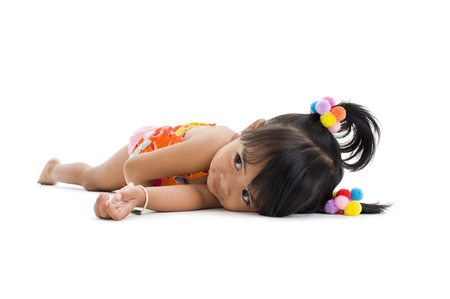cute little girl laying down, isolated on white background photo