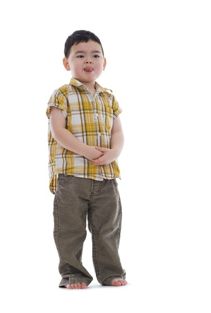 cute kid sticking out his tongue, isolated on white background photo
