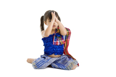 cute kid with hand folded, isolated on white background photo