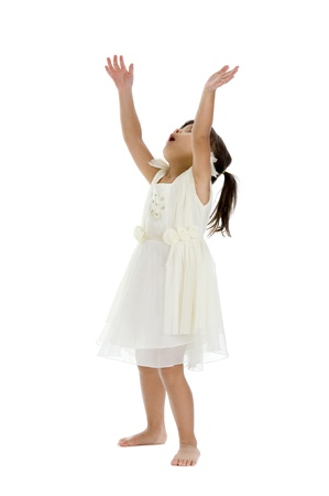 catching: cute girl trying to catch something, isolated on white background Stock Photo