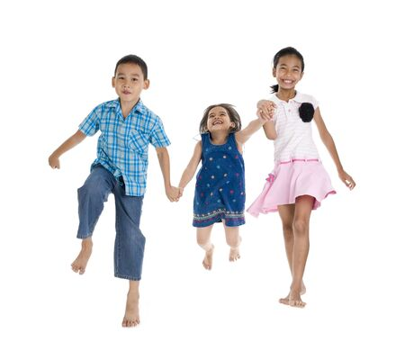 kids holding hands: siblings on the move, isolated on white background