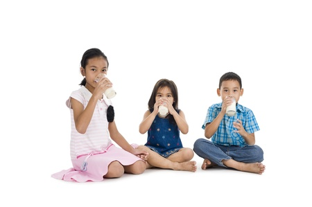 woman drinking milk: siblings drinking milk, isolated on white background Stock Photo