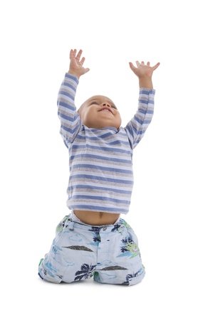 catch up: cute little boy trying to catch something coming from the top, isolated on white background Stock Photo