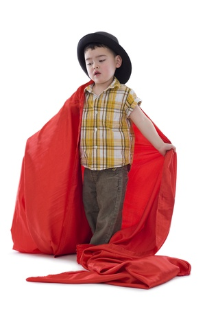 the lovely boy: sweet boy with hat and red silk fabric, isolated on white