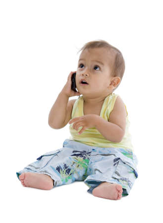 cute little boy busy on the phone, isolated on white background photo