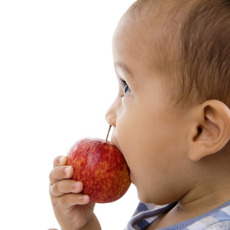 cute boy eating an apple, isolated on white background photo