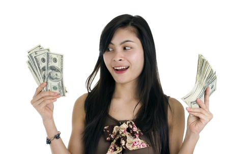win money: pretty woman happy with lots of money, isolated on white background