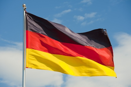 germany flag: german flag on a pole over beautiful sky