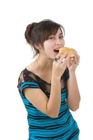 pretty woman enjoying a hamburger over white background photo