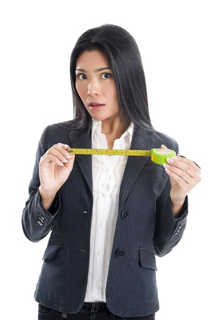 business woman with a ruler isolated on white background photo