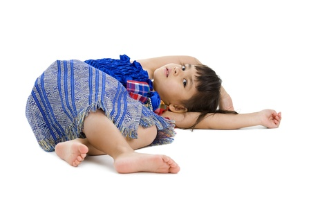 cute little girl laying on the floor isolated on white background Stock Photo - 9180020