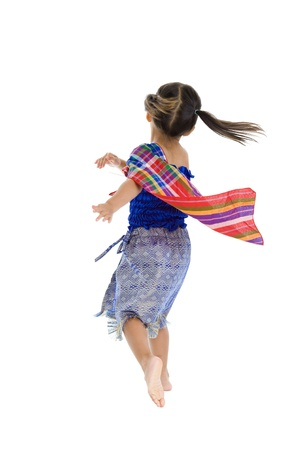 twirling: cute girl taking an action turn, isolated on white background
