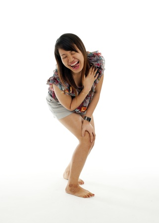 asian woman laughing her head off, isolated on white background photo