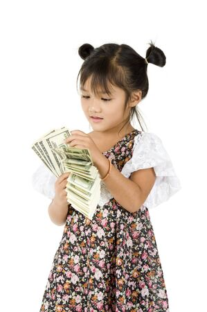 counting money: cute little girl counting money over white