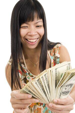 mucho dinero: feliz mujer asi�tica con un mont�n de dinero, aislada sobre fondo blanco