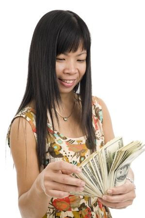 happy asian woman counting her money, isolated on white background Stock Photo - 9954695