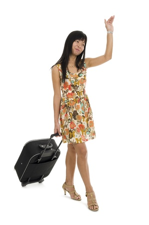woman with hand luggage waving over white photo
