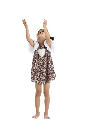 arm outstretched: little girl trying to catch something, isolated on white background
