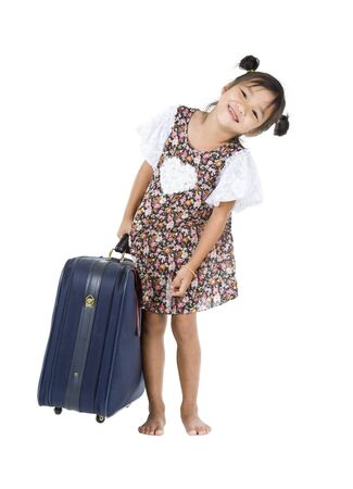 happy Asian girl carrying her heavy luggage over white background 版權商用圖片