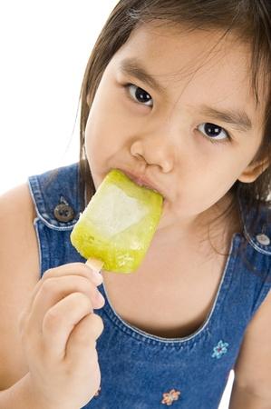 cute girl enjoying her ice cream over white background photo