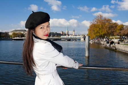 pretty asian in zurich, with the lake, a tram and two famous churches in the background Stock Photo - 10981117