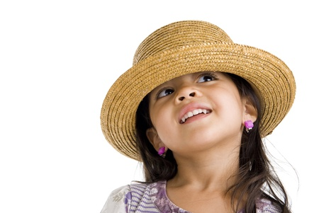 little asian girl with straw hat looking up over white