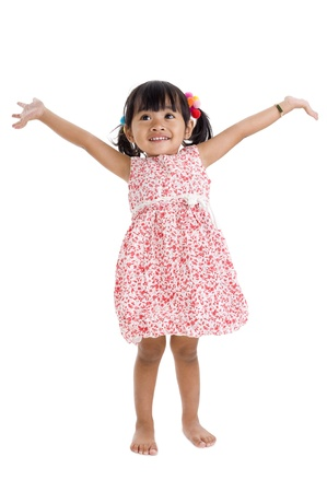 cute little girl with arms outstretched Stock Photo