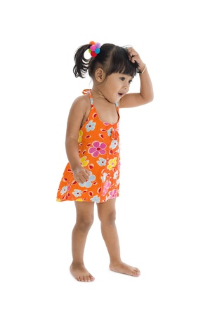 little confused girl scratching her head, isolated on white background photo