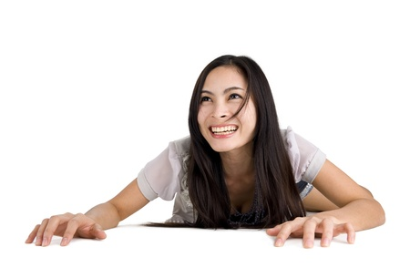 happy asian woman crawling on the floor, isolated on white background photo