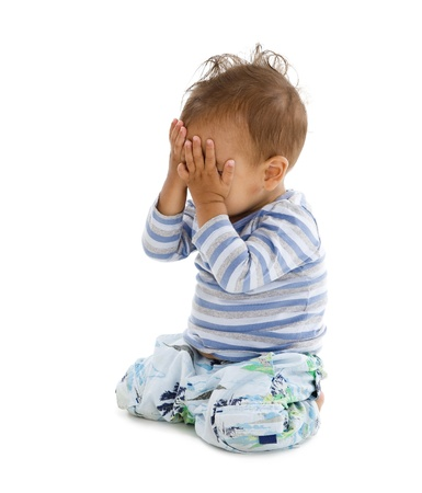 hand covering eye: little boy covering his eyes with his hands, isolated on white background