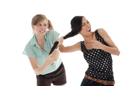 two young women having a fight over white background