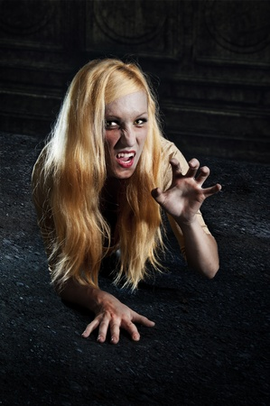 young blond vampire crawling through the night Stock Photo - 11881190