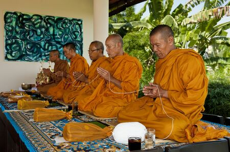 monks: Khao Yai, Thailand - April 21, 2012: Thai monks give their blessings in a wedding ceremony