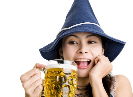 happy asian woman with beer and october fest hat photo
