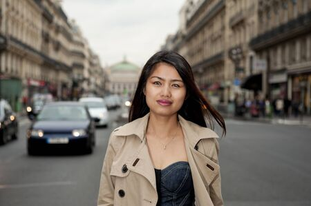 pretty asian girl walking in the streets of paris photo