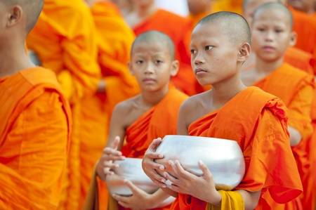 budda: Bangkok, Thailand – July 7, 2012: Alms giving-ceremony - Thousands of monks celebrate the enlightenment of Siddhartha Gautama, which dates back 2600 years ago